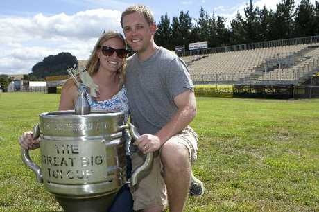 GRASSROOTS FANS: Brad and Jessica Hammond, all the way from Minneapolis, with the Tui Cup.