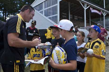 POPULAR: Hurricanes coach Mark Hammett signs autographs at Mangatainoka.