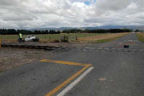 ACCIDENT SCENE: Wiltons Rd crossing, where a train and ute collided yesterday. Red cones mark the vehicle's approach.