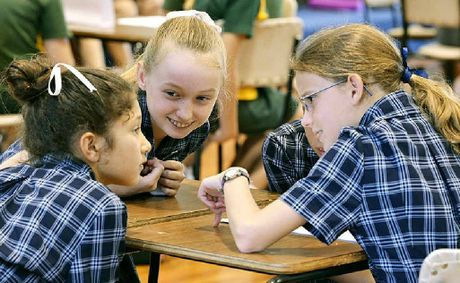 BRAIN TEASERS: Students from Ipswich Girls' Grammar School confer during the Kids' Lit Quiz.