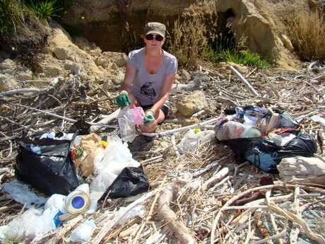 FILTHY MESS: Tracey Vickers-Anderson is disgusted by the rubbish dumped along the coastline near Waianakarua Rd.
