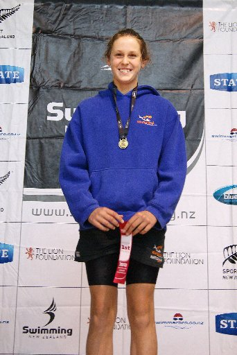 TOP FORM: Wanganui Swim Club's TOP FORM: Wanganui Swim Club's Shannon Schimanski with her gold medal in the 50m breaststroke at the New Zealand Junior Championships at the weekend. PHOTO/SUPPLIE