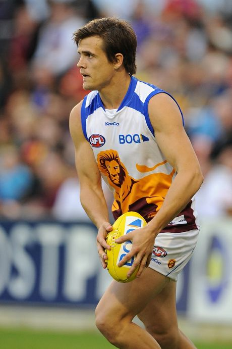 Jed Adcock of the Lions looks to kick during the round 17 AFL match between the Gold Coast Suns and the Brisbane Lions at Metricon Stadium on July 21, 2012 on the Gold Coast, Australia.
