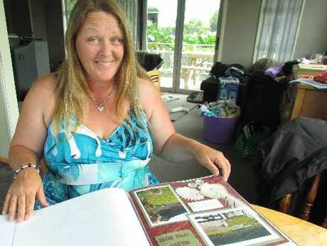 Steffy Mackay relaxing at her home with one of her favourite pastimes: scrapbooking.