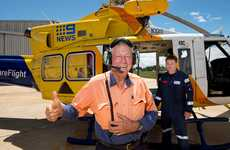 Clive Berghofer gets ready to fly over Toowoomba with pilot Jan Steen as he celebrates $1 million in donations to RACQ CareFlight.