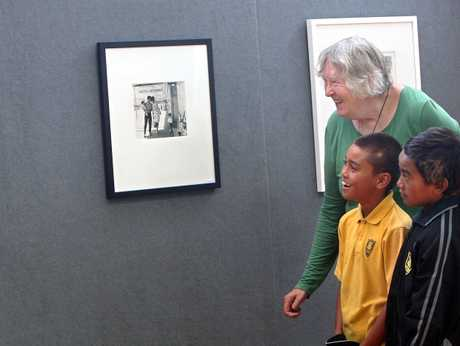 Renowned photographer Ans Westra shows Rotorua Primary School pupils Rangi Tukiwaho, 11, (left) and Capri Tepurei, 10, photographs she took in the city about 50 years ago.
