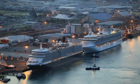 Ocean liner, Queen Elizabeth, docks in front of the cruise ship Daimond Princess, at the Port of Tauranga.