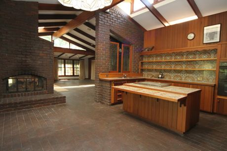The brick and timber homestead is characterised by an open-plan layout with dual fireplaces, high-railed ceilings and three bedrooms plus an office or fourth bedroom.
