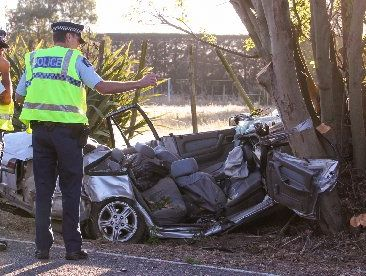FATAL SPOT: Police crash unit investigators at the scene of the fatal crash at Meeanee which took the life of a Napier teen. PHOTO/GLENN TAYLOR HBT130634-02
