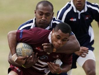 Soqeta Lowata of the Nadi Blues takes down a player from the Wesleyan Titans during the weekend's inaugural Fijian Sevens tournament at Old Boys.
