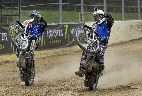 New Zealand speedway champion Jason Bunyan and 2012 world champ Chris Holder in action.