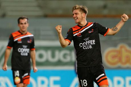 Luke Brattan of the Roar celebrates their victory after the final whistle during the round 18 A-League match between the Perth Glory and the Brisbane Roar at nib Stadium on January 26, 2013 in Perth, Australia.
