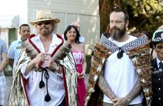 CLOAKED: Barry Gibb and his son Stephen after they were adorned with korowai (cloaks) before yesterday's Maori welcome. PHOTOS/GLENN TAYLOR