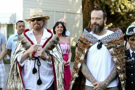 CLOAKED: Barry Gibb and his son Stephen after they were adorned with korowai (cloaks) before yesterday&#39;s Maori welcome. PHOTOS/GLENN TAYLOR