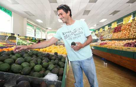 Marcio Pires shops for avocados at the City Market in Tauranga.
