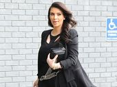 KIM Kardashian can't wait for her pregnancy to be over because she is so uncomfortable.