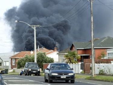 TYRES BURN: The black acrid smoke from burning tyres in the used-car scrap metal yard on Rogers St billowed skyward and was seen at Maxwell, 25km north-west of Wanganui.