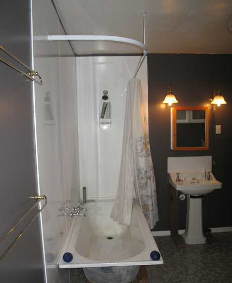 BATHROOM MAKEOVER: A temporary shower was installed, while (right) the second layer of gib goes up.PHOTOS/NELSON LEBO