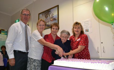 TAKE THE CAKE: Chairman of Clarence Village Limited Geoff Shepherd, Yvonne Robards, June Vasey, Betty McLennan and Isis West celebrating Dougherty Villa's 20th birthday.