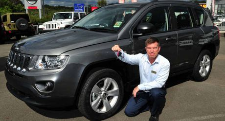 WINNING TIP: Gary Crick sales consultant Tom Phelan with the Jeep Compass.