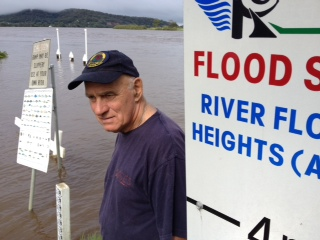 Ken Crampon checks the river heights at Maclean.