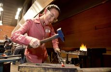 Jessica Pokorski tries her hand at blacksmithing at the Cobb+Co Have a Go day .