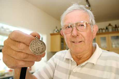 HUNTING: Richmond resident Alan Williamson is seeking the relatives of a medallion which he found in the back yard of his rental property.