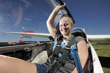 FLYING HIGH: 18-year-old Emma Brooks, pictured, and 74-year-old Brian Crook recently completed solo flights with Tauranga Gliding Club.