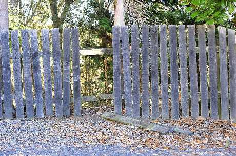 DAMAGE: The stolen vehicle left its mark on the Apata family's fence.