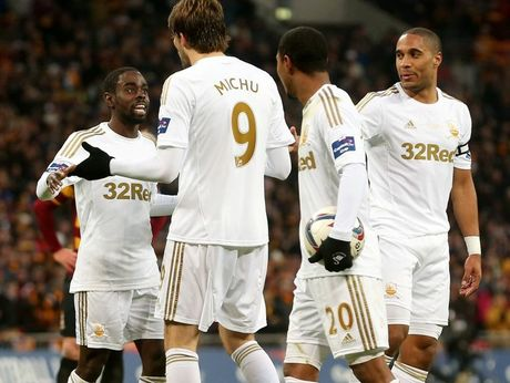 Michu of Swansea City breaks up an arguement between Nathan Dyer of Swansea City and Jonathan de Guzman of Swansea City during the Capital One Cup Final match between Bradford City and Swansea City at Wembley Stadium on February 24, 2013 in London, England.