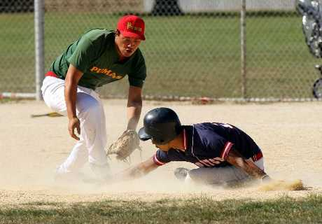 SAFE AS: Fast Pitch base runner Giovani Matairangi, right, beats a tag from Maraenui Pumas short stop Jordan Mita as he slides into second base during his team's 9-1 win on Saturday.