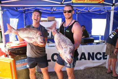 HAPPY CHAPPIES: Tristan Sanders, left, and Ben Louis reeled in a couple of whoppers during a very successful fishing contest.