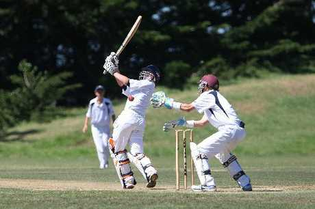 SWING AWAY: Wanganui High School&#39;s Adam Gill goes after a delivery, watched by United keeper Chris Sharrock.PHOTOS/BEVAN CONLEY
