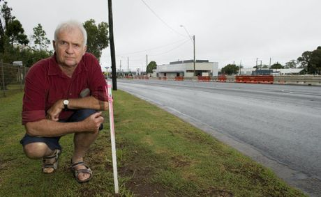 Neil Riethmuller lives opposite the McDonalds development on the corner of Davis St and Anzac Av (between James and Tor Sts) and will loose some of his footpath in the road widening process.