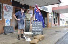 Laidley Hire and Farm Supplies owner Paul Boody (left) and Bruce Clark keep an eye on the level of Laidley Creek.