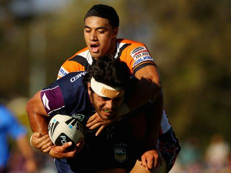 Tohu Harris of the Storm is tackled during the NRL trial match between the Melbourne Storm and Brisbane Easts at Gosch&#39;s Paddock on February 2, 2013 in Melbourne, Australia. 