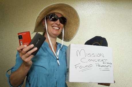 FOUND: Napier Police property officer Suzanne Signal displays some of the property left behind after the Mission Concert on Saturday night.