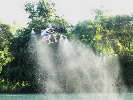 EXTERMINATOR: Alastair Gossal and Ross McAulay's remote-controlled weed-killing helicopter is the first to be made in New Zealand.