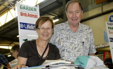 BIG READ: Pirkko and Greg Otto of Toowoomba with a trolleyload of books at the 2011 Lifeline Bookfest.