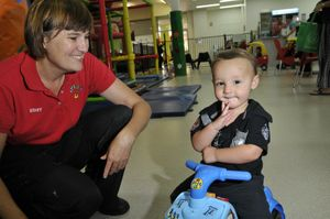 iPlay co-owner Mel Doherty meets with 16-month-old Jasper Godden at her indoor children's entertainment caf . Story on staying happy during bad weather. Photo Dave Noonan / The Chronicle