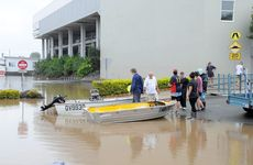 Boats are launched in preparation to clean the outside of shops as floodwaters recede in the Gympie CBD. River Road. Photo Tanya Easterby / The Gympie Times