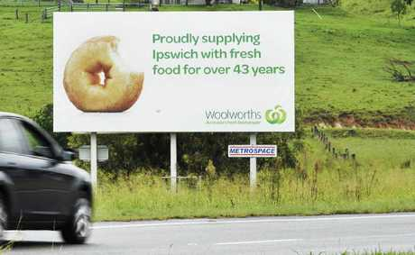 FRESH FOOD: The offending Woolworths billboard; (inset) chef Jamie Oliver.