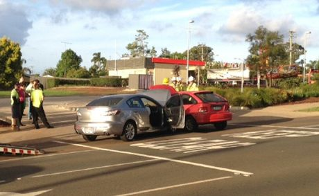 Emergency services respond to a minor crash near the driveway of the Alderley St Hungry Jacks restaurant