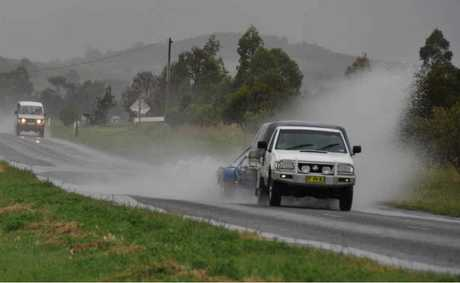 Motorists travelling through large puddles.
