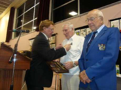 Jack Jeffares and Rob Sturmer receive the Melvin Jones Fellowship from past district governor Ray Lawrence.
