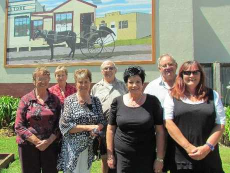 Among those celebrating the unveiling of the Bank of New South Wales mural last week were (from the back left) Maree Liddington, Stewart Wakeling; Mid Rocard, Maureen Drylie; Sheila Connell, and Nancy Fatches.