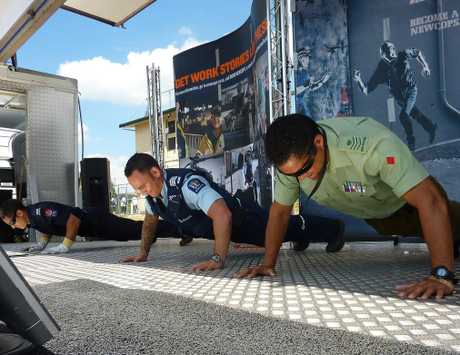 Sergeant Darren-Leigh Paki faces off with the NZ Fire Service and NZ Army in an onstage press-up competition.