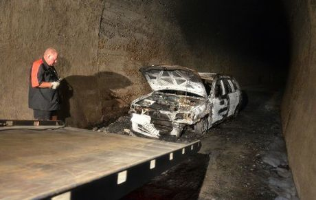 The stolen and burned-out car is recovered from the rail tunnel on the Twin Coast Cycle Trail.