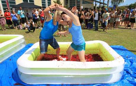 "Bay of Plenty Polytech early childhood students Hannah Burgess (left) and Keri Rorvik try out jelly wrestling during ""O Week"" celebrations."