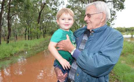 NEW AND OLD: Life long Wooroolin resident Ken Dalton, 76 and his great-grandson Tyler Fuller-Sandys, 2 are both amazed to see the town's swamp over flowing for the first time.